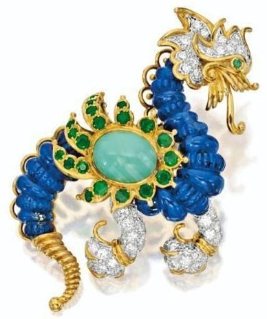 Dragon Brooch by Cartier  Lapis Lazuli, Cabochon Turquoise, Emerald, and Diamonds in 18 karat yellow gold, via Sotheby's