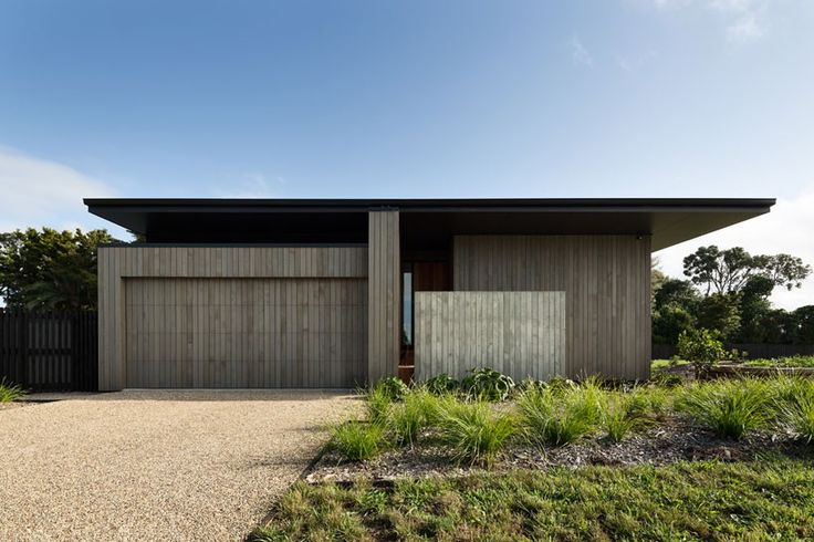characterized by an oversized dark roof which rests on thick timber walls, the play of shadow is the main concept dictating this private home.