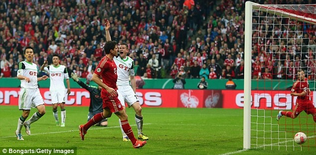 Mario Gomez scoring the first of his hat-trick for FC Bayern Munich against Wolfsburg in the 2013 DFB-Pokal semi-final at the 80 minute mark (Bongarts/Getty Images in UK Daily Mail)