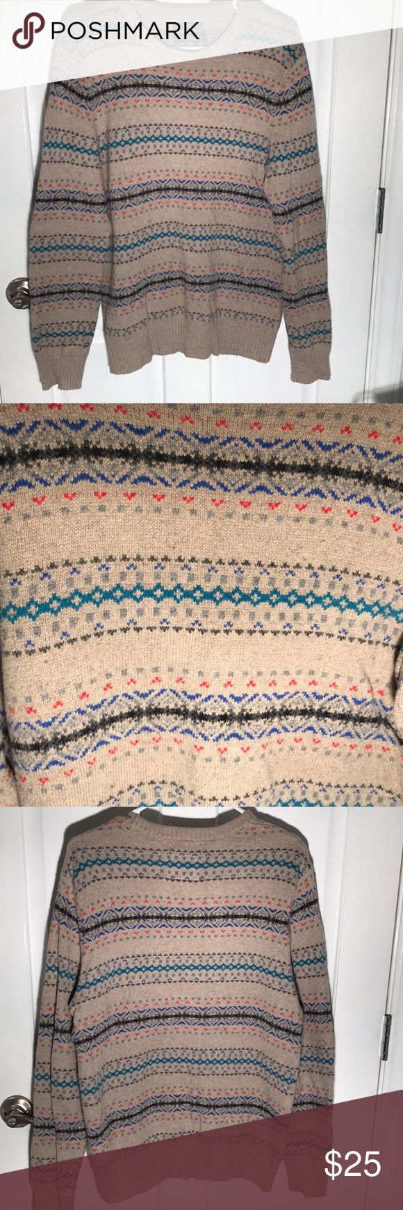 American Eagle Men's fair isle sweater American Eagle men's fair isle crew neck sweater with rubbed cuffs and hem. Great neutral beige background with vibrant blue, teal, red and grey throughout. No pilling, worn only once. American Eagle Outfitters Sweaters Crewneck