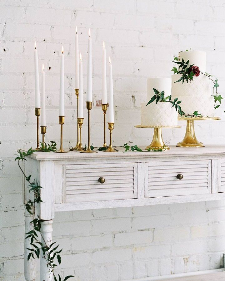 White taper candles of gold candle holders | fabmood.com #weddingcaketable #caketable #whitecandles #candles #whiteandgold #goldwedding #whitewedding