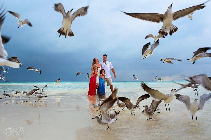 Beach family portraits on the island of Isla Mujeres near Cancun. Mexico portrait and wedding photographers Del Sol Photography.