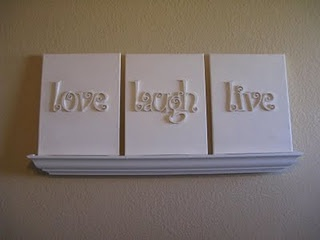 DIY Easy Canvas Wall Art ~ 3 art canvases (sized 11x14), 13 wood letters (for the words love, laugh, live), spray glue, spray paint... love these!