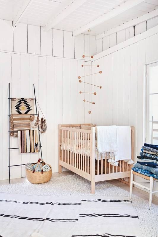simple modern nursery with a lot of white and natural wood