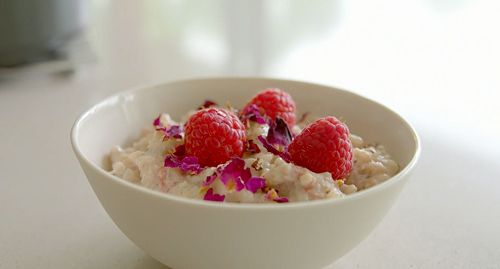 Tom Kerridge served up a low calorie rice pudding with fresh raspberries, rose water and skimmed milk on Tom Kerridge's Lose Weight For Good. The ingredients are: 200g pudding rice, 800ml skimmed milk, 4 tsp granulated sweetener, 1 fresh vanilla pod, 1/4 tsp cardamon, 6 or 7 drops of rosewater, 60ml single cream replacement, fresh raspberries and dried rose pedals to garnish. See Tom's recipes in his book titled: Lose Weight for Good: Full-flavour cooking for a low-calorie di...