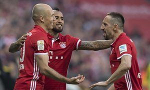 Arjen Robben, left, celebrates scoring Bayern Munich's third goal against Dortmund with Franck Ribéry, right, five years after the pair came to blows in a Champions League semi-final.