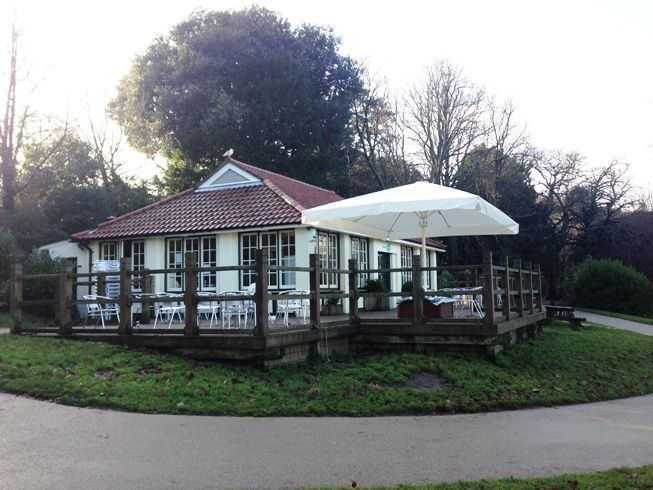 Here's a 6m x 4m giant umbrella in cream at Eat @ Ours, Alexandra Park in Hastings.    Although this was on a weighted base, the base & concrete slabs are covered with a finished wooden timber seat designed & made for the purpose, with green cushioned seating.  Customers are now able to relax in style under the umbrella!   Supplied & Installed by Shades of Comfort Ltd