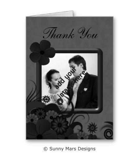 Black Gothic Floral Hibiscus Wedding Thank You Photo Note Cards by sunnymars of SunnyMarsDesigns in association with Zazzle.  This custom small folded greeting card features a stylish, modern, trendy, elegant Goth dark gray and black swirly hibiscus floral decoration design. Click through to see matching wedding stationery and related products.