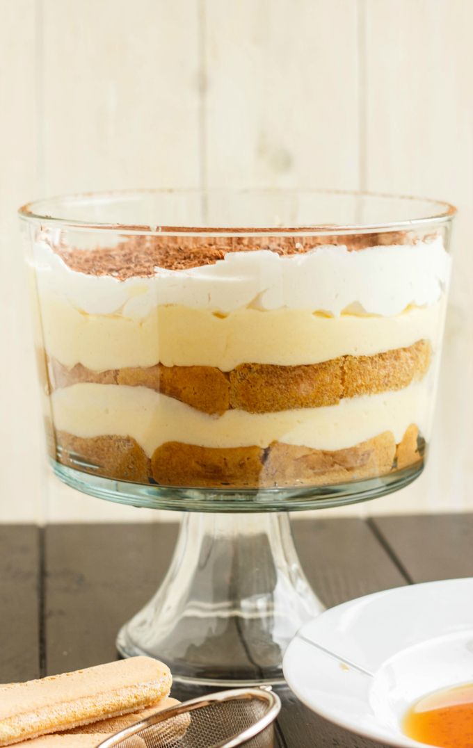 Ultimate Tiramisu Trifle - Layers of ladyfingers, mascarpone cheese, and Kahlua.