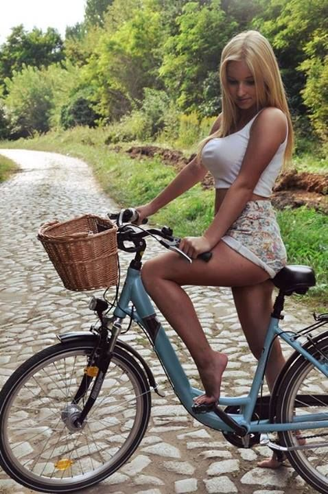 Naked Girl On A Bicycle