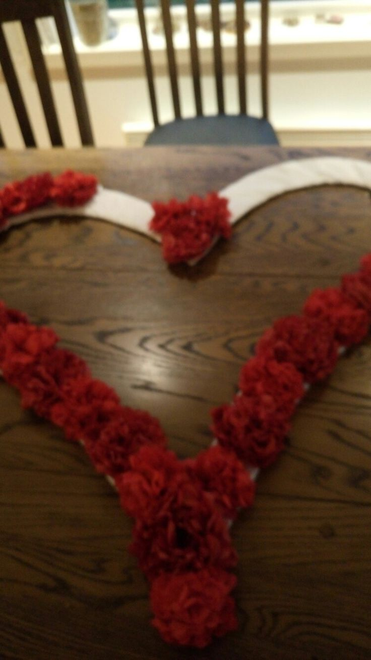 Soon finished with a huge red heart iam making for my friends weeding. I uses a big paper nox. I cut a heart shape and made alot of paper.roaea out of red paper napkings. I.made the.roses like ponpons but small.