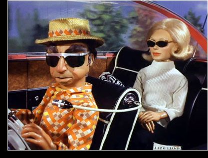 Parker & Lady Penelope - Thunderbirds. Must be casual Friday for Parker.