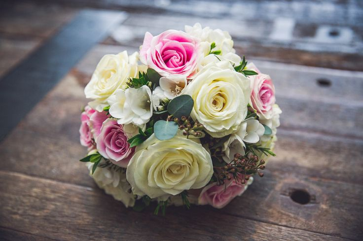 Posy bridal bouquet of Rosita Vendela pink roses, Polar Star white roses and white freesia. Photo by @ammichalska   Flowers by Janie- Calgary Wedding Florist  www.flowersbyjanie.com