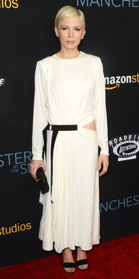 Michelle Williams may have exposed her hipbone, but she covered up everywhere else with her racy (yet demure) white Louis Vuitton dress at the Manchester by the Sea premiere, complete with black LV accessories that complemented the black belt detailing.