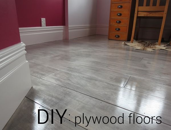 DIY plywood floors with a custom greywash/driftwood finish.
