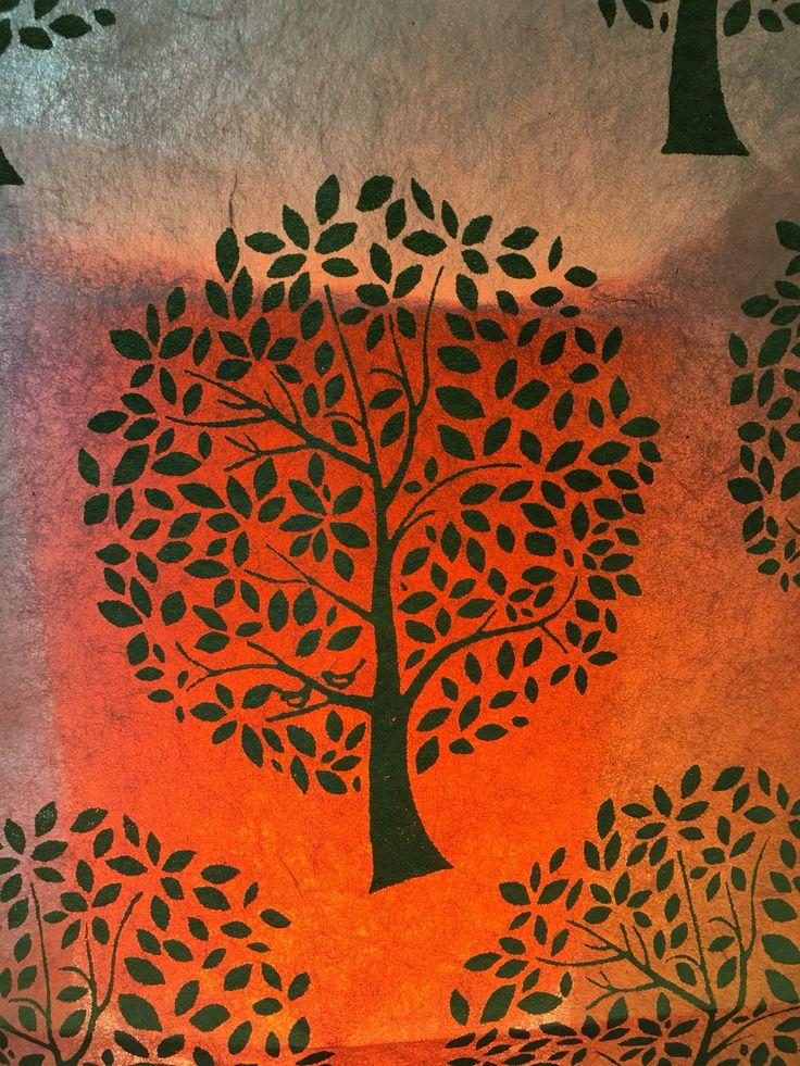 Fair trade handmade paper over a light