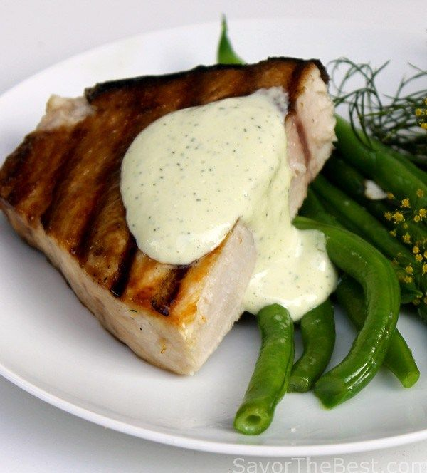 A recipe for Swordfish steak that is grilled to perfection and served with a lemon-dill aioli sauce.