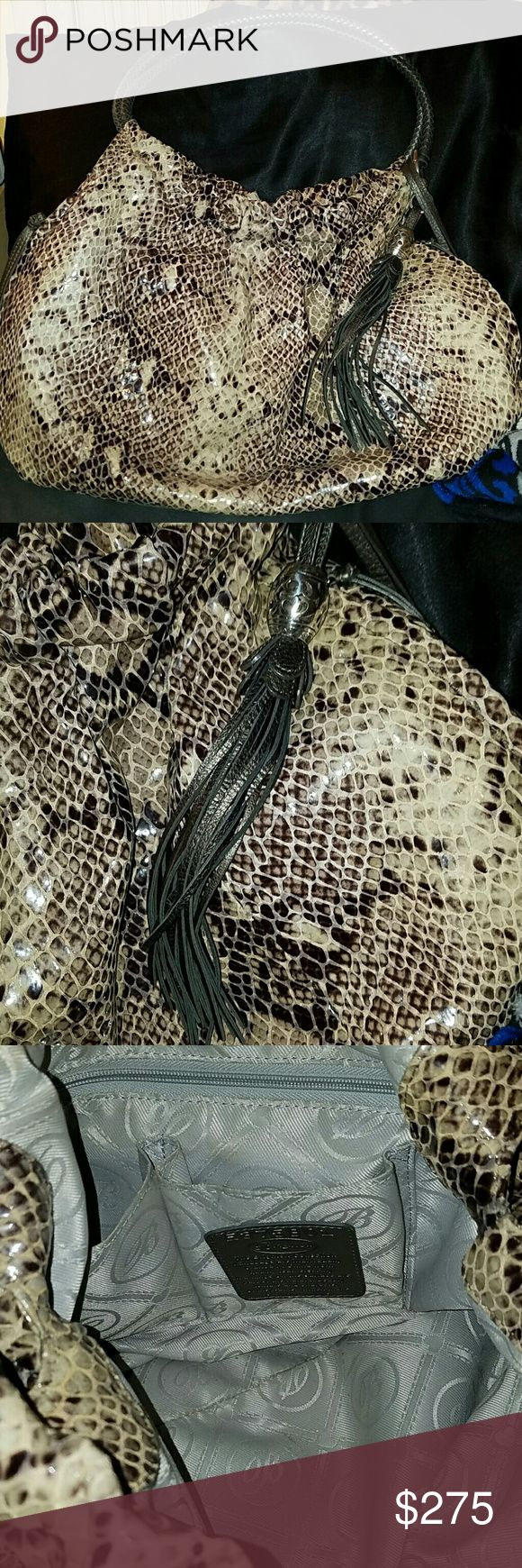 Brighton Nolita snakeskin 100% authentic  Used a handful of times No major signs of wear Slouchy hobo style  Leather Braided straps Comes with box and dust bag Brighton Bags Hobos
