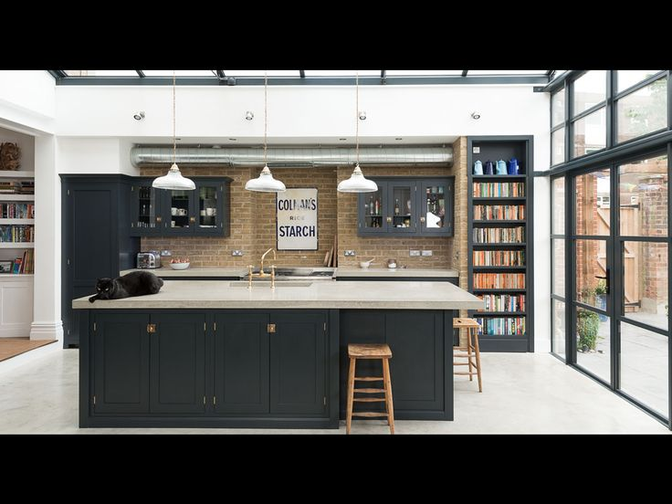 Love the color of the cabinets, the bookshelf, the brick, and the window ceiling