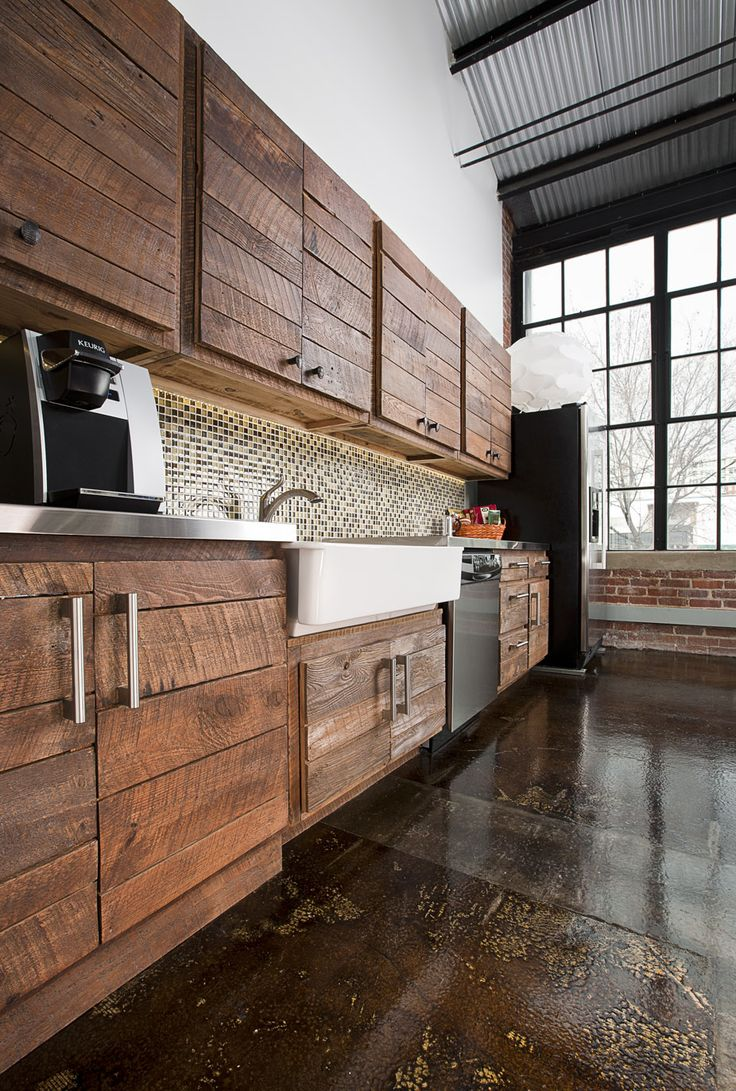 stamped/colored concrete floors & rustic wood cabinets with stainless drawer pulls