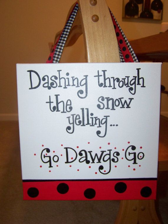 This lil darlin measures 10x10 and reads Dashing through the snow yelling... Go Dawgs Go!. Includes a coordinating ribbon for hanging. Can