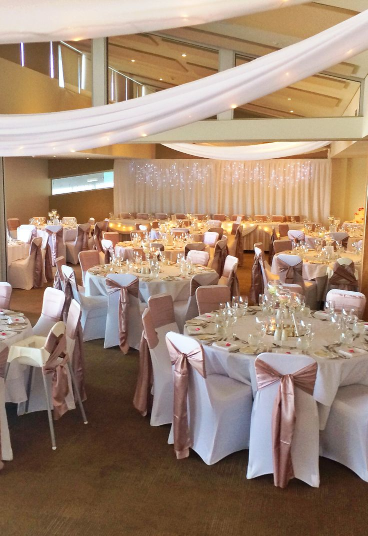 Fairy lights and swagging add a magical atmosphere to the function room at The Surf Club Mooloolaba. Thanks to @Beedazzled Events for the stunning room set-up.