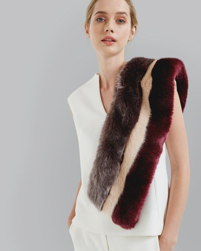 SHOP AW16: Ruffle up your style feathers with a helping hand from the WYLA faux fur scarf. Boasting a statement colour block design and Ted's signature printed lining, this flamboyant accessory is sure to turn heads all season long.