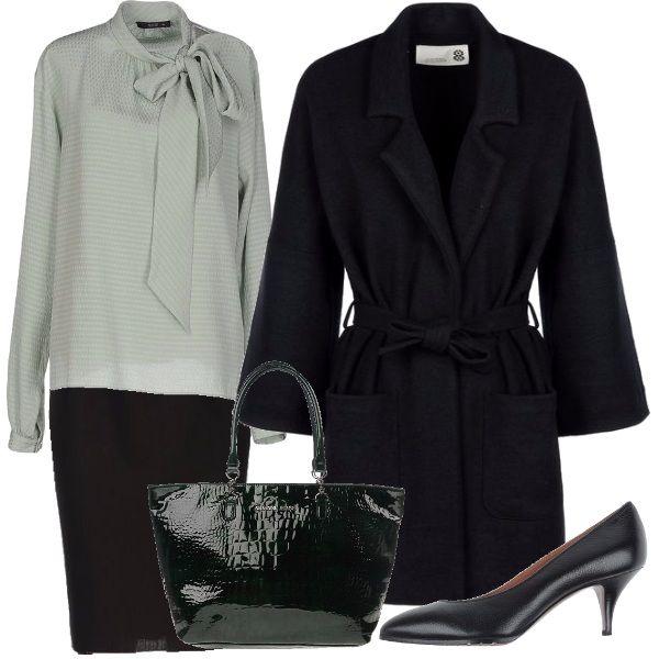La camicia con il fiocco, vero must di stagione, di un delicato colore, ben si abbina a una gonna a matita, al cappottino con maniche 3/4, décolleté e la borsa stampa cocco.