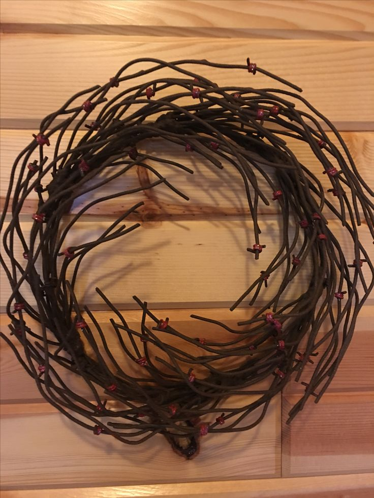 Made of 33 feet of rustic barbed wire from Northern Minnesota farmsteads! This wreath is approx. 12 inches across. Finished in deep rustic brown tones with red 'berry' highlights this wreath is perfect all year round! Our best seller this season! Each handmade to order.