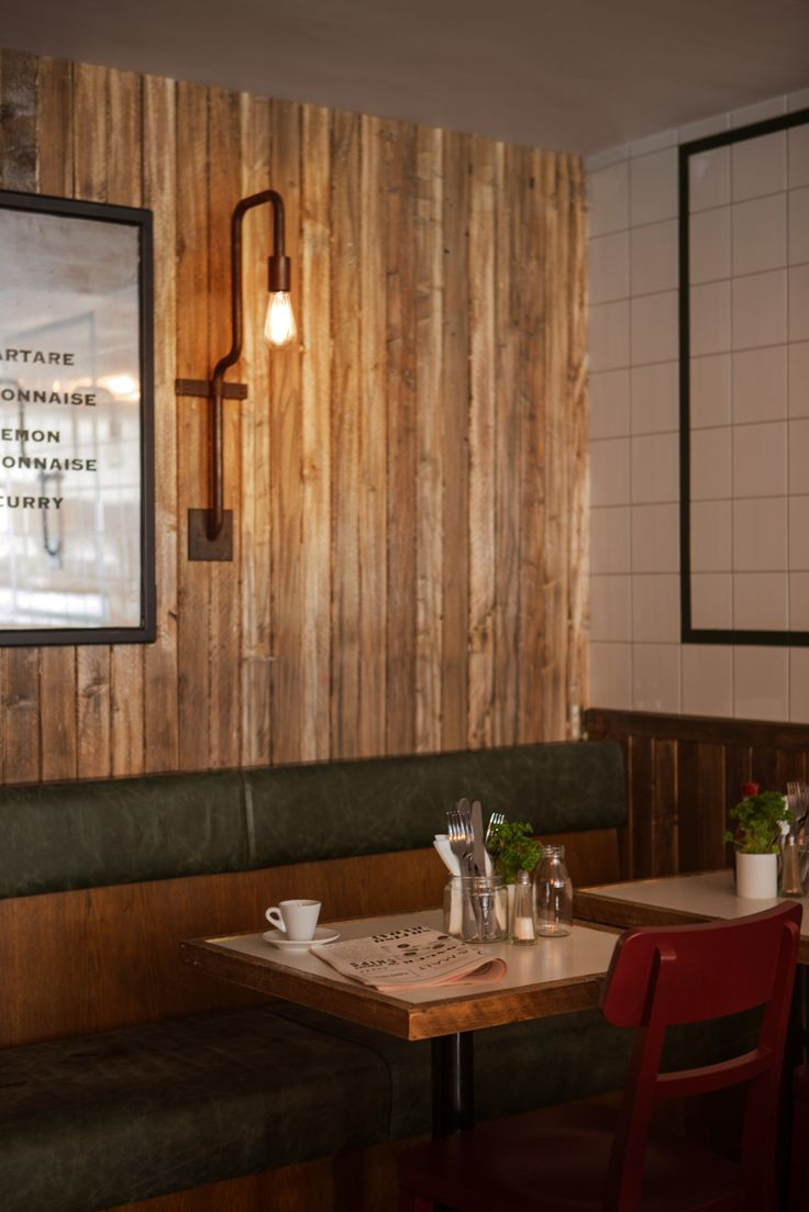 RECLAIMED TIMBER PANELING, RETRO GREEN BANQUETTE AND RED CHAIR AT KERBISHER & MALT BY ALEXANDER WATERWORTH INTERIORS