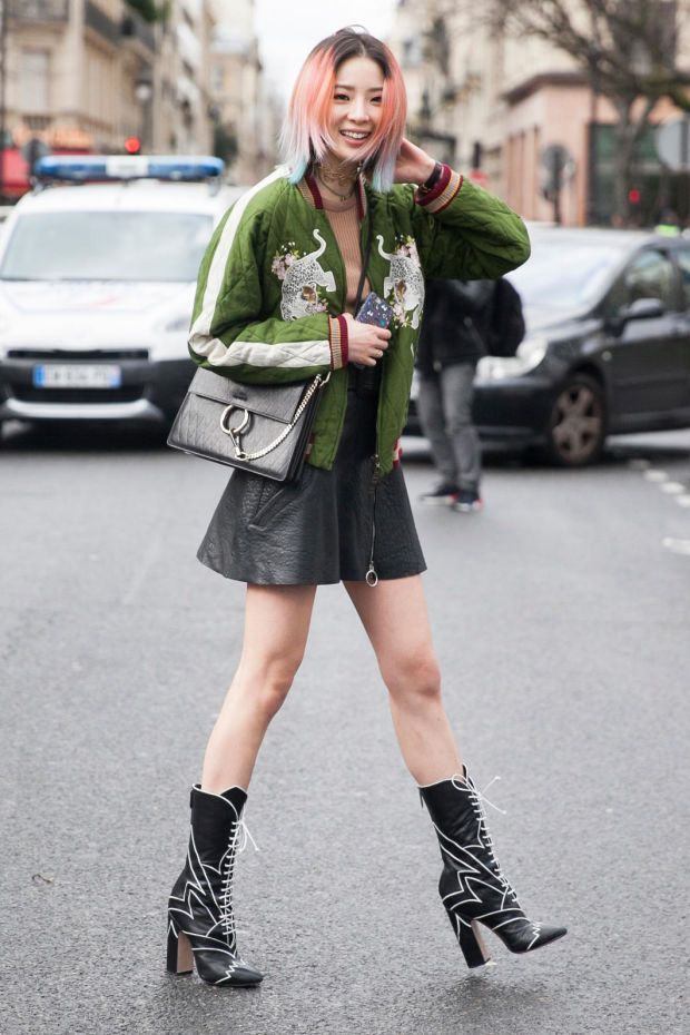 Irene Kim in Miu Miu boots and Chloe jacket at Paris Fashion Week. Photo: Emily Malan/Fashionista