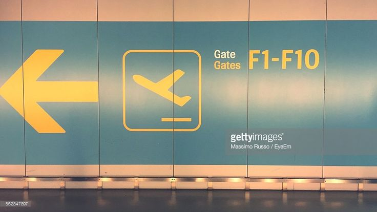 Stock Photo : Close-Up Of Information Sign At Airport