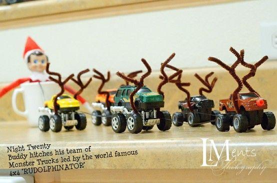 Elf test driving his monster truck reindeers