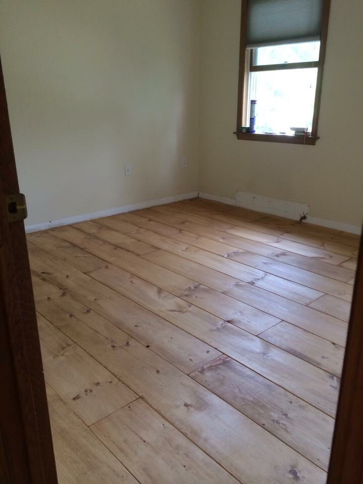 """Go to the lumber yard & buy 1"""" thick x 10"""" wide premium white pine 8' boards at $0.85/linear foot. hand sand all the edges so they aren't sharp/look older. Then cut them in a staggered length & place down to assure u like the pattern. apply PL400 subfloor glue along the bottoms & lay them down butted up board to board (the sanded edges provided some small gaps between them for character.) he used a nail gun/compressor with finish nails for extra hold. Apply Watco Danish Dark Walnut Oil."""