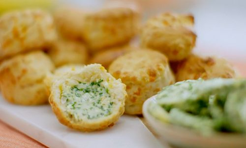 Nadiya Hussain served up cheese scones with chive butter sauce on Nadiya's British Food Adventure. The ingredients are: 175g self-raising flour, 50g strong white flour, plus extra for dusting, ¼ tsp onion salt, 55g unsalted butter, 25g Red Leicester, grated, 150ml whole milk, plus extra for glazing. For the chive butter: 80g unsalted butter, softened, 1 tsp rock salt and 20g chives, finely chopped.     The recipe is available in Nadiya's new book titled: Nadiya's British Food Adventure…