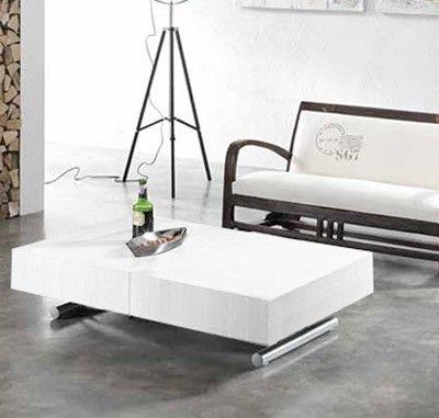 Tavolino da salotto alzabile e allungabile, trasformabile in tavolo da pranzo, con base in metallo color silver e top in melaminico colore bianco con cinque allunghe da 33,5 cm ciascuna.Misure: L. 120-220.5 P. 80 H. 30-76