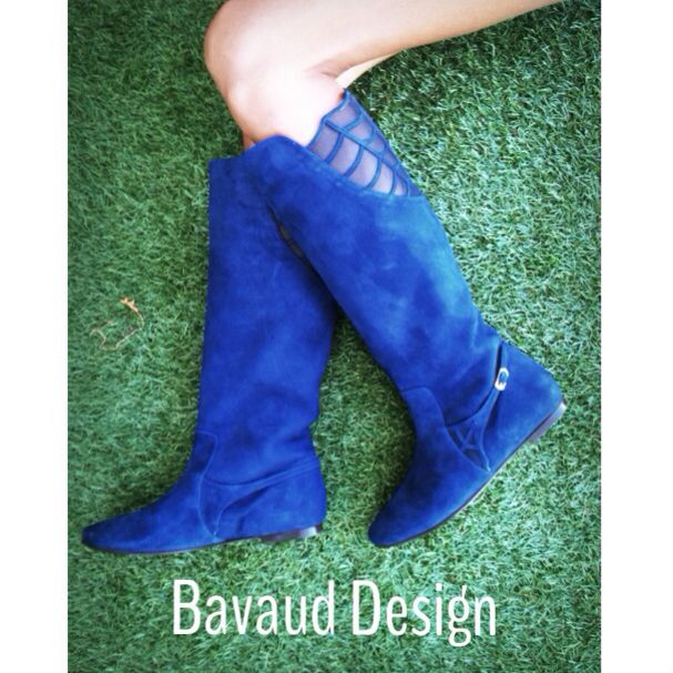 Blue suede boots with a web detailing.