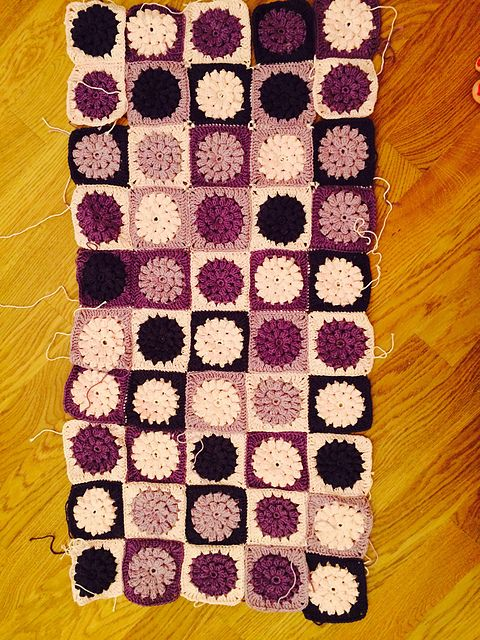 I use 4 colours, which can be combined in 6 different 2-colour combinations, giving 12 different squares (by alternating background and flower). A = pink B = lila C = purple D = aubergine  Combinat...