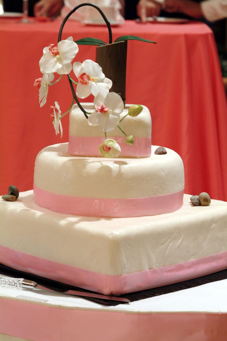 Asian inspired pink-themed wedding cake with orchids