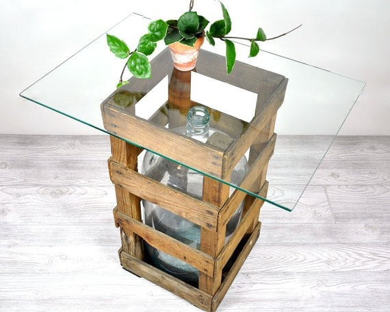 cute idea! old bottle and crate becomes a table.