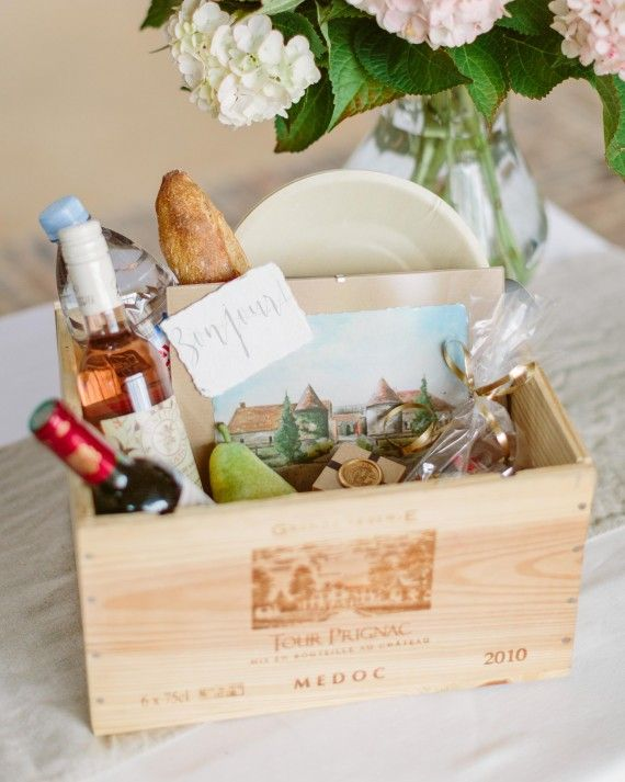 Upon arrival, guests received a French wine crate filled with quintessential goodies from Paris. Each box held the fixings for a traditional Parisian picnic including wine, baguettes, cheese pairings, jam, a pear, and disposable wooden plates and cutlery. An illustration of the venue by the mother-of-the-bride, served as a beautiful memory. In addition, guests were surprised at turndown service in their guest rooms, when small, sealed boxes (like the one pictured above) adorned each pillow…