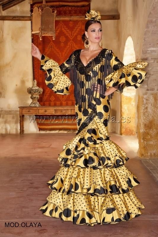 Viva la Feria - Moda Flamenca ...contemporary dress for Las Ferias in Sevilla .... yellow with black polka dots and fringe ...