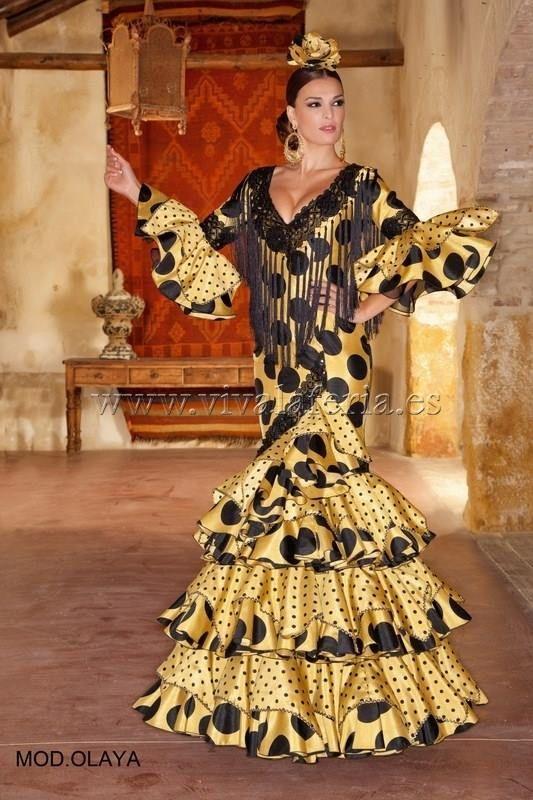 Viva la Feria - Moda Flamenca ...contemporary dress for Las Ferias in Sevilla .... yellow with black polka dots and fringe ...