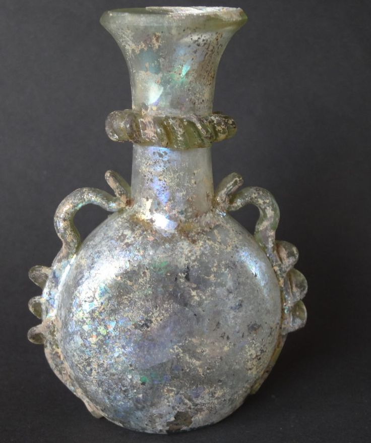 UMAYYAD / EARLY ABBASID CALIPHATE BOTTLE. SYRIA. IRIDESCENT CLEAR GLASS GOURD. 7TH to 8TH CENTURY AD.
