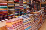 fabric is easier to get to when stored vertically: Stores Vertical,  Tobacconist Shops, Display Ideas, Westerns China, Store Displays, Well Display, Stores Display, Business Ideas, Display Bhutan