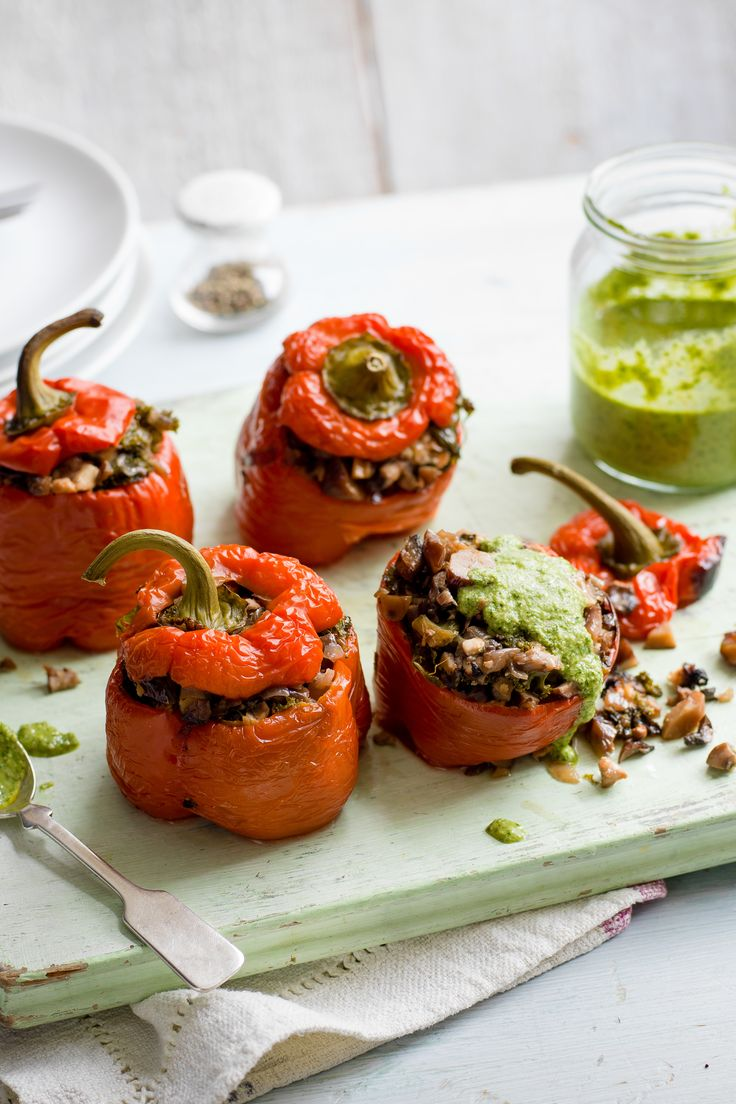 These slow-cooked stuffed peppers are perfect for a veggie feast. Packed with mushrooms, feta and oregano, and served with a drizzle of vibrant green watercress and walnut pesto, this easy vegetarian recipe is a real crowd-pleaser. | Tesco
