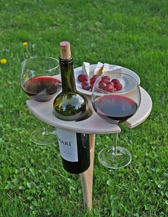 This beautifully handcrafted folding wine stand is a must have for all wine lovers. It has plenty of room for your bottle of wine, two glasses and a plate of your favorite wine parings. Perfect for outdoor wine festivals, family picnics or just a quiet evening in your backyard! 1. Foldable design with handle for easy storage and take alongs 2. Durable Materials - Fiberglass rod pushes into the ground with little effort 3. Locks in place in both positions, flat and folded 4. Custom…