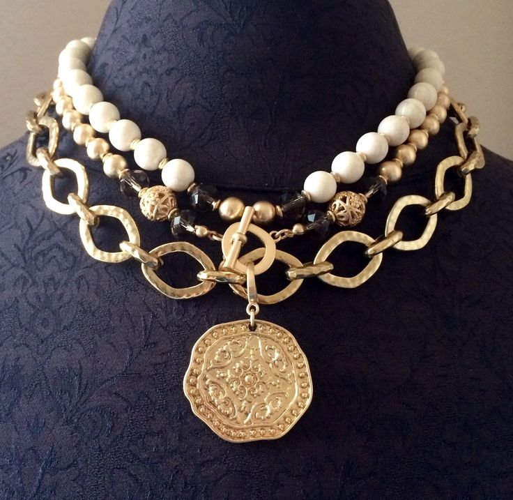 Double the Pompeii  necklace and layer with the Golden Rule necklace. It gives  you the expensive but not the expensive price tag!  Jewelry by Premier Designs.