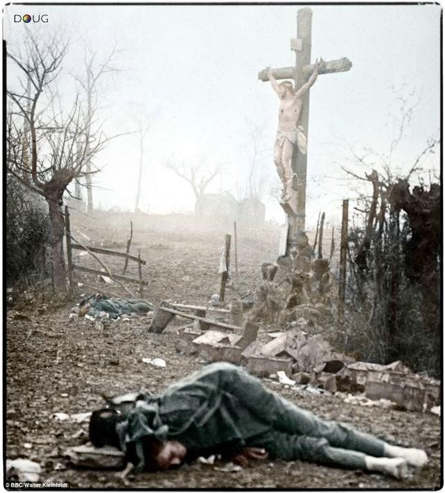 French dead beneath a roadside shrine, WWI.  (If you look you'll notice someone has scavenged his shoes . . . not an uncommon occurrence throughout history)