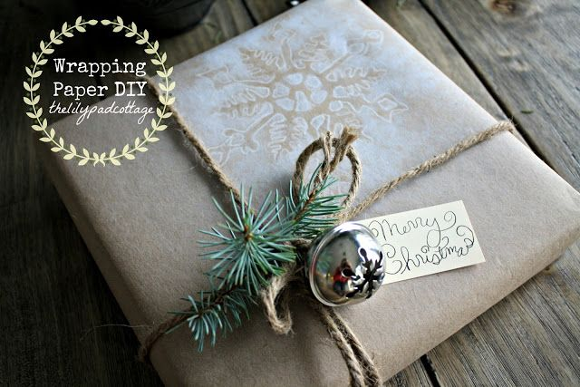 DIY Christmas Snowflake Wrapping Paper | Use white spray paint and a felt snowflake  stencil, on kraft paper, to create a doily effect snowflake.  Add twine, greenery and a jingle bell.